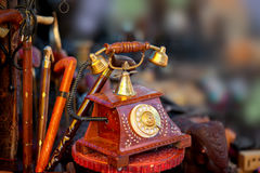 Antique phone artifact. Close up shot of antique phone artifact and other handicrafts made in India Stock Photo