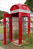 Antique phone booth. The British red phone booth.No phone Royalty Free Stock Photos