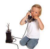 Antique phone and boy Stock Images