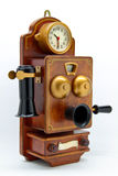 Antique phone with clock on white isolation royalty free stock photo