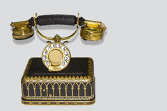 Antique phone. Golden brown on white background, Wireless (irony Stock Images