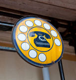 Antique phone sign Royalty Free Stock Image