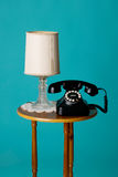 Antique phone on table Royalty Free Stock Image