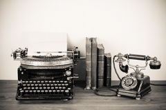 Antique phone and typewriter Royalty Free Stock Photo