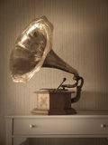 Antique phonograph. In classical interior with vegnetting and aged filter applied Royalty Free Stock Photography