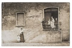 Antique photo family children house on background Royalty Free Stock Images