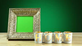 Antique photo frame with green screen and burning home candles. Royalty Free Stock Photo