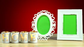 Antique photo frame with green screen and burning home candles.