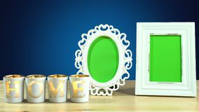 Antique photo frame with green screen and burning home candles. Royalty Free Stock Photos