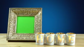 Antique photo frame with green screen and burning home candles. Stock Images