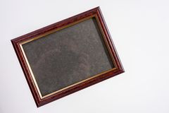 Antique photo frame isolated on white. Background Royalty Free Stock Image