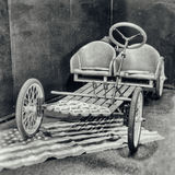 Antique photography of a pedal car without petrol engine. Royalty Free Stock Photo