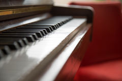 Antique piano close up red background stock images