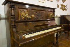 Antique piano with detailed carving Stock Image