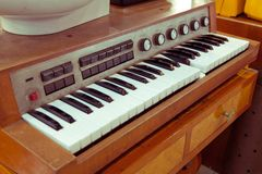 Antique piano keys and wood grain Stock Images