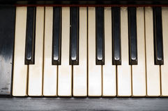 Antique piano with yellowish old keyboard close-up Stock Photography