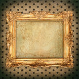 Antique picture frame over aged wallpaper. vintage grunge backgr. Antique picture frame over aged polka dot wallpaper. vintage grunge background Royalty Free Stock Photo