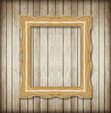 Antique picture frame on wooden wall ;Empty picture frame Royalty Free Stock Photos