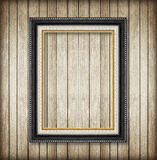 Antique picture frame on wooden wall ;Empty picture frame Stock Photos
