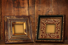 Antique picture frames. Antique picture frames on an antique cabinet shelf Stock Images
