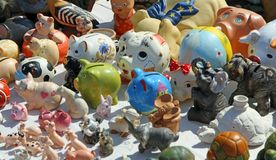 Antique piggy banks for sale at flea market stall Royalty Free Stock Photo