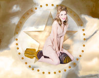 Antique pin-up girl on missile. Bombshell blond. Antique design portrait of a hot retro pin-up girl wearing polka dot dress sitting on war missile shooting Royalty Free Stock Images