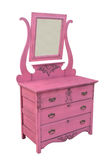 Antique pink dresser isolated. Antique wooden dresser with mirror, painted pink.  Isolated on white Royalty Free Stock Images