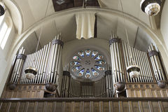 Antique pipe organ in decaying church Royalty Free Stock Images