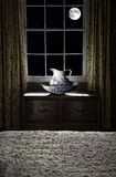 Antique pitcher and basin at window Stock Photography