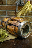 Antique pitchfork and wooden wheel hub on burlap sack against ru Stock Images
