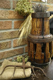 Antique pitchfork and wooden wheel hub on burlap sack against ru Royalty Free Stock Image