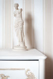 Antique plaster statue. On the background of striped wallpaper Royalty Free Stock Images