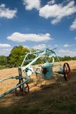 Antique plough. Horse drawn plough in hay field Stock Images