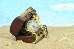 Antique pocket clock in a  treasure chest Stock Images