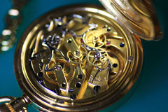 Antique pocket watch. Close up of gold antique pocket watch with collar Royalty Free Stock Image