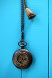 Antique pocket watch. On blue wooden table Royalty Free Stock Images