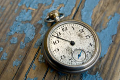 Antique pocket watch. Clock on a peeling blue wood floor Stock Photo