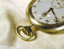 Antique pocket watch. Old watch on silk Royalty Free Stock Photos