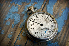 Antique pocket watch. Clock on a peeling blue wood floor Royalty Free Stock Image