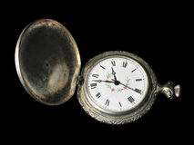 Antique Pocket Watch. An antique pocket watch separated on black Stock Images