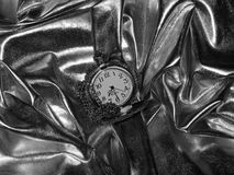 Antique pocket watch on a black and white photo Royalty Free Stock Photos