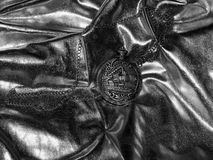 Antique pocket watch on a black and white photo Royalty Free Stock Image