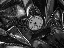 Antique pocket watch on a black and white photo Stock Images