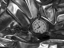 Antique pocket watch on a black and white photo Royalty Free Stock Photography