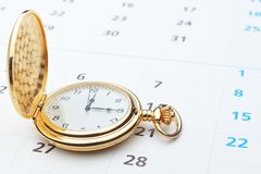 Antique pocket watch on a calendar. Stock Photography