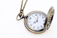Antique pocket watch with chain. On white background Royalty Free Stock Photos