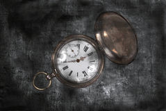 Antique pocket watch on a dark vintage background Stock Photos