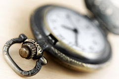 Antique pocket watch on the desk Royalty Free Stock Images