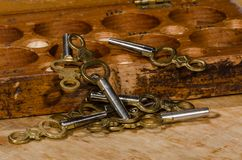 Antique Pocket Watch Keys Scattered on the Watchmaker's Bench. Antique Pocket Watch Keys Scattered on the Watchmaker's Repair Bench stock photography