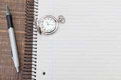 Antique pocket watch on notebook for notes. stock images